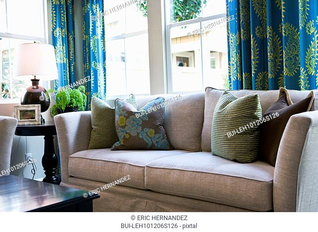 Cushions on sofa in contemporary living room;Tustin;California;USA