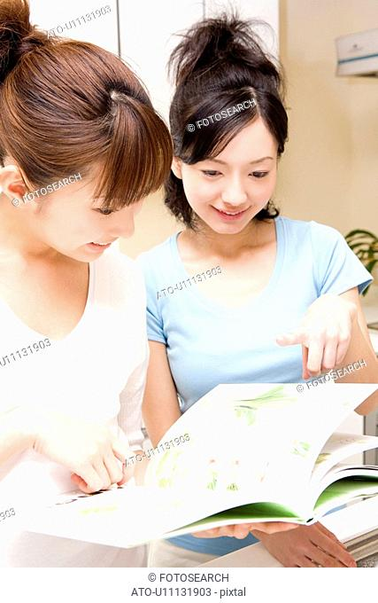 Japanese women reading a cooking book