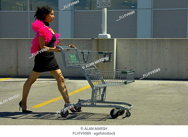 Woman Pushing Shopping Cart in Cocktail Dress and Boa