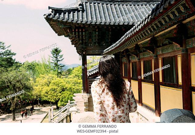 South Korea, Gyeongju, woman visiting Bulguksa Temple