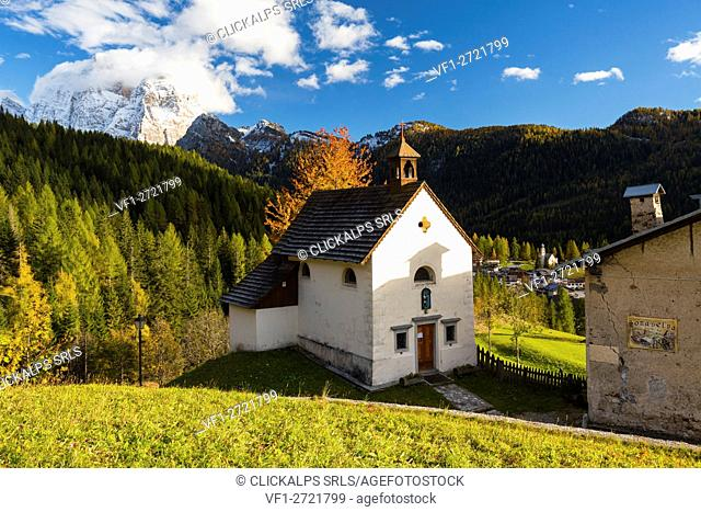 San Osvaldo church with Monte Pelmo in the background. Val Fiorentina, Veneto, Italy