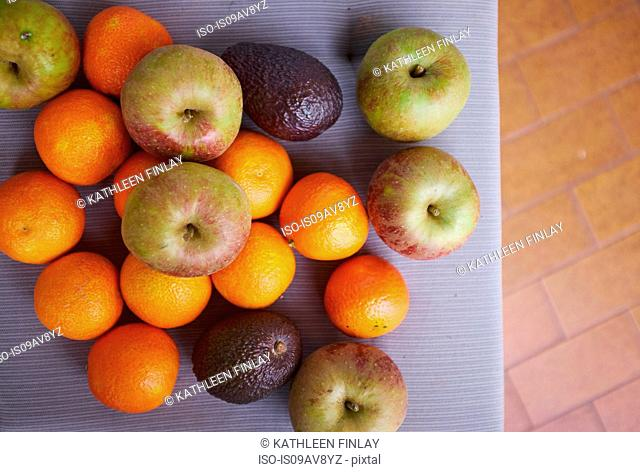 Selection of fruit on table, overhead view