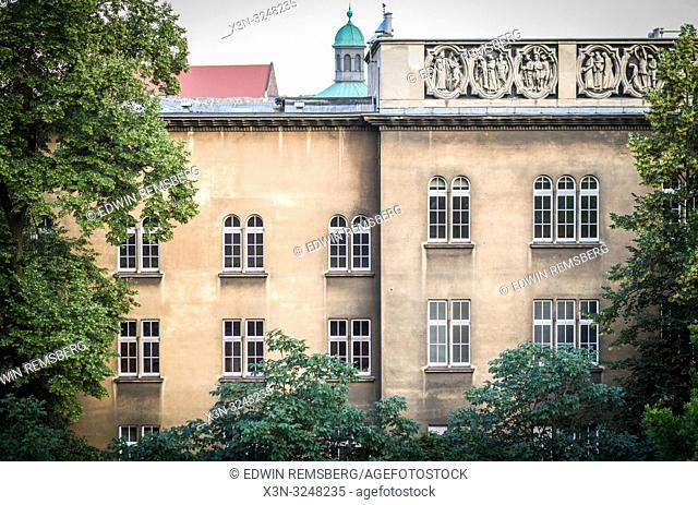 Exterior of building framed by tree branches, Krak—w, Lesser Poland Voivodeship, Poland