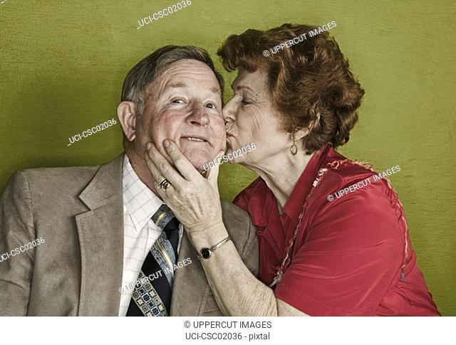 Senior woman kissing husband's cheek