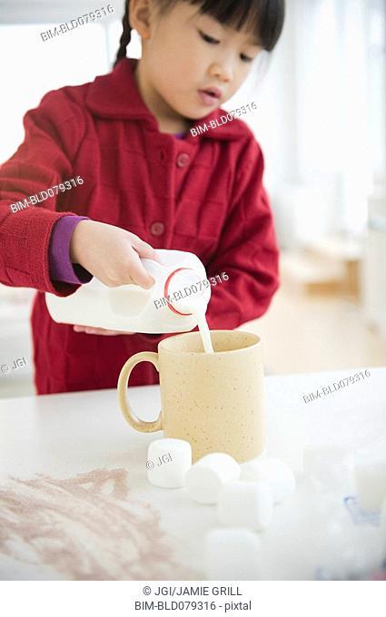 Chinese girl making hot chocolate