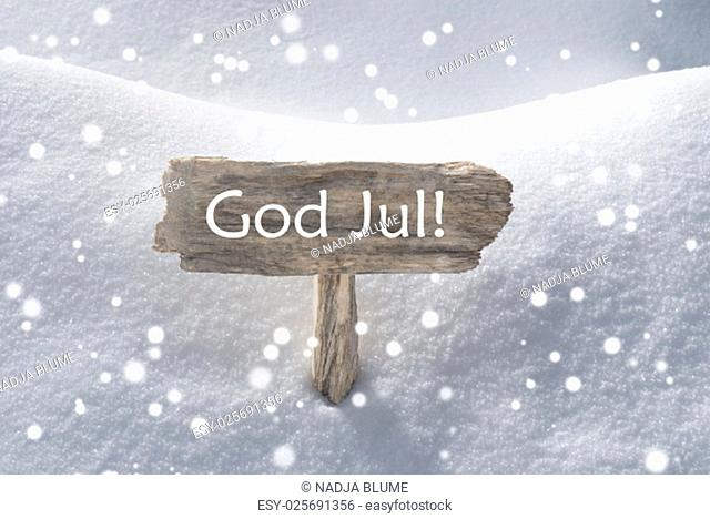 Wooden Christmas Sign With Snow In Snowy Scenery. Swedish Text God Jul Means Merry Christmas For Seasons Greetings Or Christmas Greetings