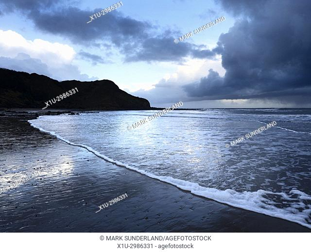 Osgodby Point or Knipe Point and Ebbing Tide at Dusk Cayton Bay Scarborough North Yorkshire England