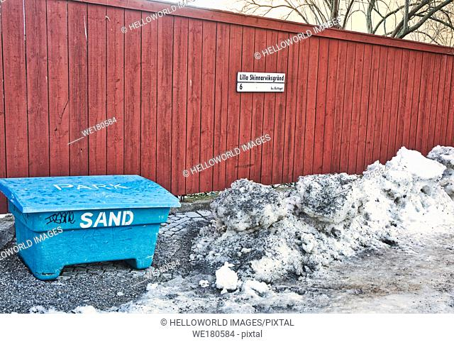 Sandbox for gritting in winter, Lilla Skinnarviksgrand, Sodermalm, Stockholm, Sweden, Scandinavia. The alley got its name in 1806 from the tanneries located...