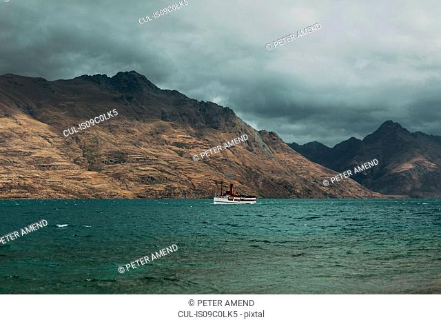 Scenic view, vessel sailing past mountains, Queenstown, Canterbury, New Zealand