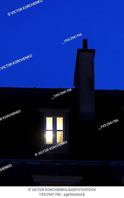 Lonely window illuminated at night