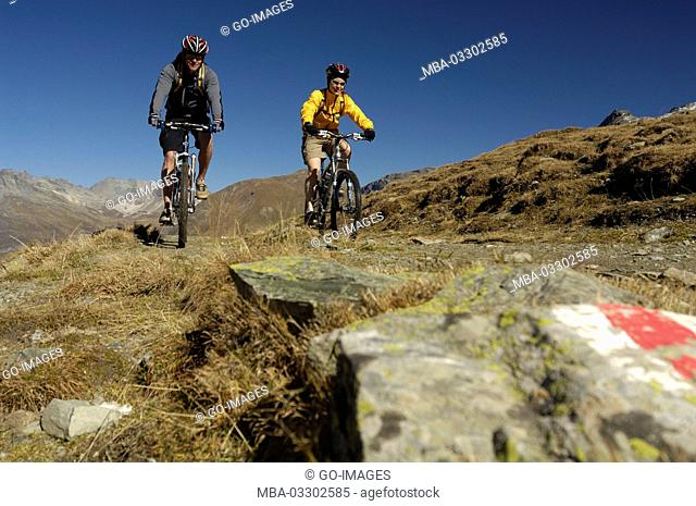Mountain biker while Septimerpass, Canton of Grisons, Switzerland