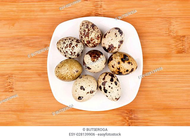 The picture quail eggs on a wooden board