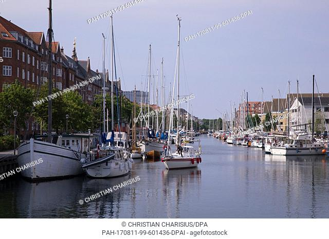 A sailboat sailing through a canal in the Christianshavn district of Copenhagen, Denmark, 06 June 2017. The district arose in 1619 and lies on an artificial...