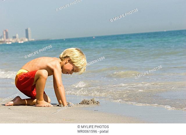 digging at the beach