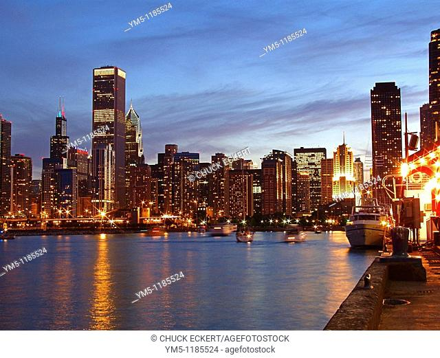 View of Chicago's skyline from Navy Pier at dusk