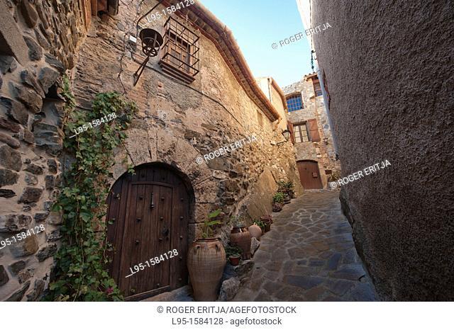 Street view and entrance door in La Vilella Baixa, Catalonia, Spain
