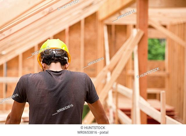 Hispanic carpenter working at a construction site