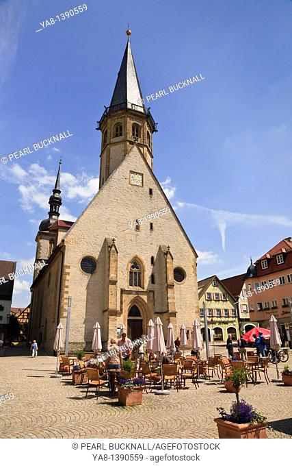 Marktplatz, Weikersheim, Baden-Wurttemberg, Germany, Europe  Outdoor cafe by St George's Church in medieval town square on the Romantic Road Romantische Strasse