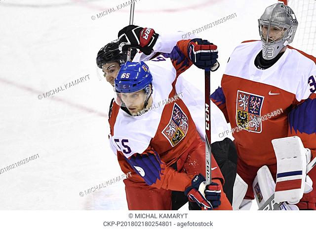 L-R Simon Moser (SUI) Vojtech Mozik and Pavel Francouz (both CZE) in action during the Czech Republic vs Switzerland ice hockey match within the 2018 Winter...