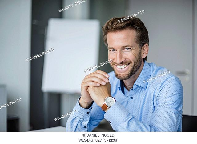 Portrait of laughing businessman in the office