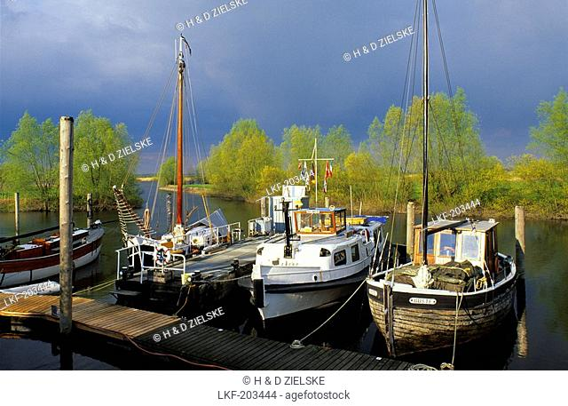 Boats at a jetty on the river Elbe, Lower Saxony, Germay