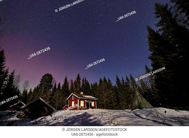 Illuminated house against night sky, Varmland, Sweden