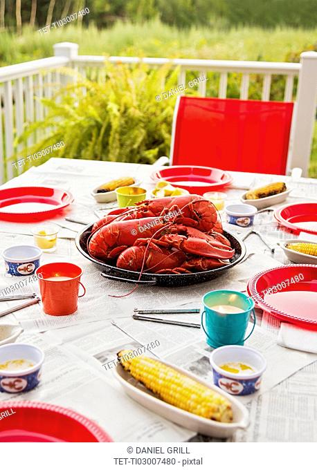 Plate with lobsters on dining table