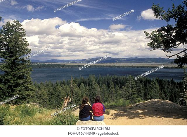 Grand Teton National Park, overlook, Jenny Lake, WY, Jackson Hole, Wyoming, People sitting at Inspiration Point looking at the scenic view of Jenny Lake in...