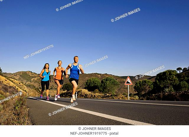 Runners running on road
