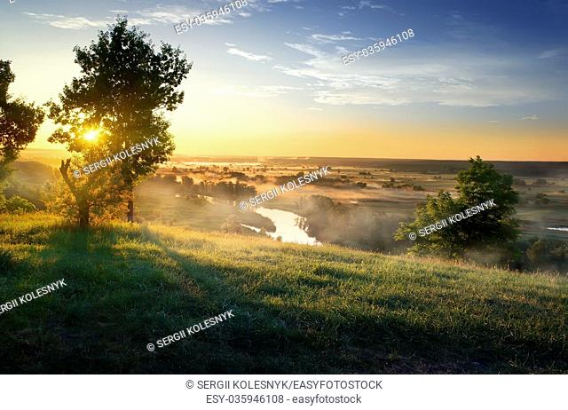 River in steppe at beautiful sunrise in summer