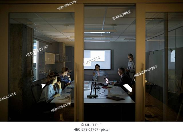 Business people meeting in dark conference room