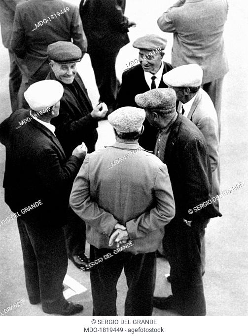 Some men chatting in the street. Alcamo, May 1968
