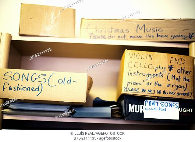 stock shelves with boxes containing sheet music. Songs, Christmas Music, Violin and Cello, Part Songs, Old Fashioned Songs