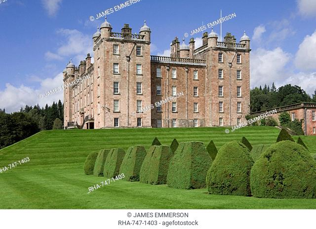 The 17th century Renaissance Drumlanrig Castle (Pink Palace) built by the 1st Duke of Queensberry William Douglass, viewed from the topiary garden