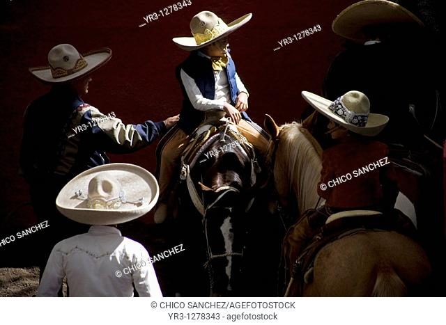 Mexican charros visit at the National Charro Championship in Pachuca, Hidalgo State, Mexico. Escaramuzas are similar to US rodeos