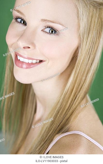 A portrait of a young blonde woman, smiling