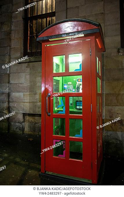 Red telephone box with green light, Sydney, Australia