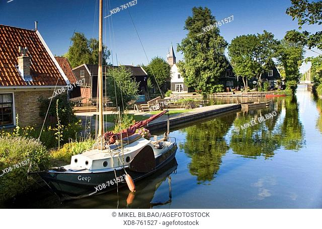 Canal with sailboat in Edam, Holland, Netherlands, Europe