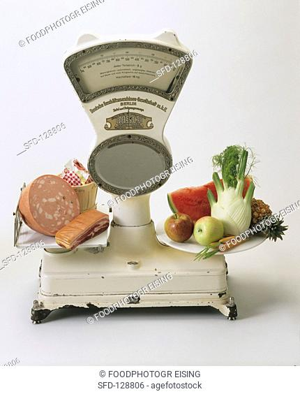 A Scale Weighing Healthy Food Against Unhealthy Food