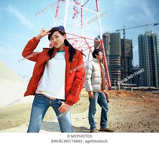 young Asian standing on a construction site