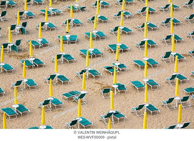 Italy, Jesolo, Deserted beach with deck chairs, elevated view