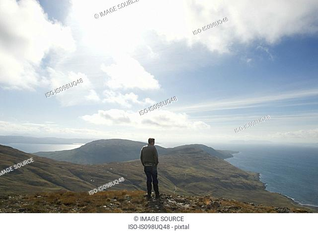 Man looking at view of landscape