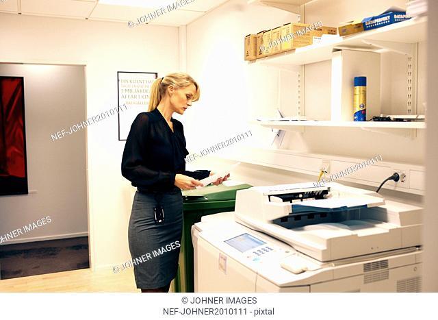 Businesswoman in office storeroom