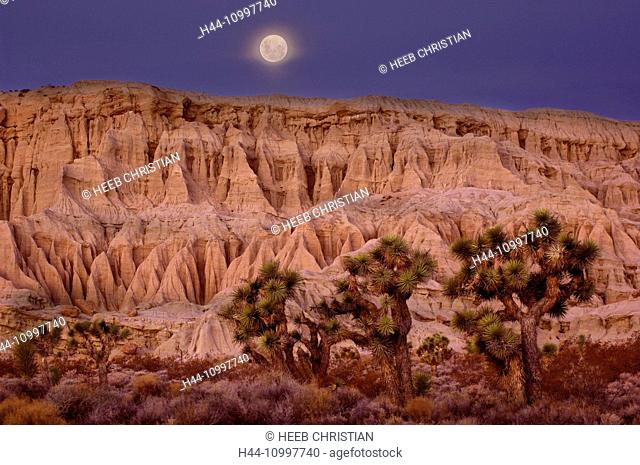 Full moon setting over Badlands at Red Rock Canyon State Park, Dawn, California, United States of America