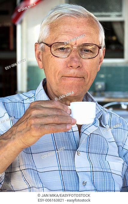 Close up of senior man enjoying cup of coffee