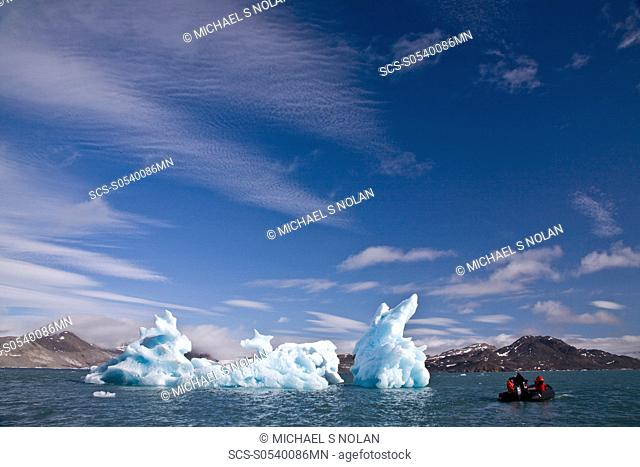 Calved icebergs from the glaciers at Blomstrandhalv¯ya in Kongsfjord on the western side of Spitsbergen in the Svalbard Archipelago, Norway