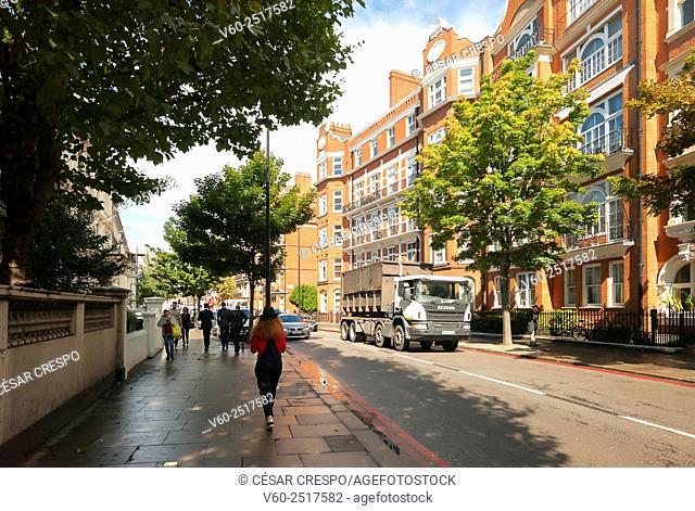 -Woman walking in Earl's Court Zone- London United Kingdom