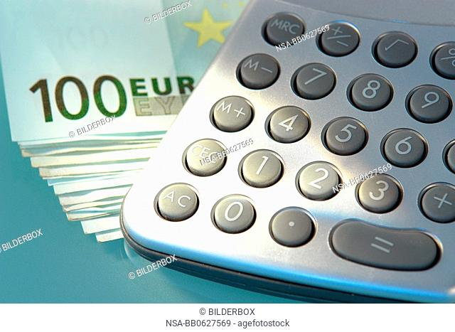 Euro banknote and calculator