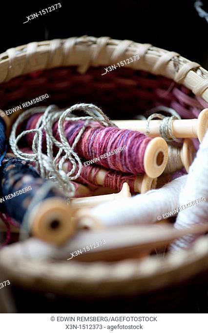 Basket of spools of thread