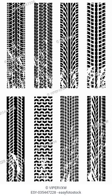 Various grunge tyre track silhouettes on white
